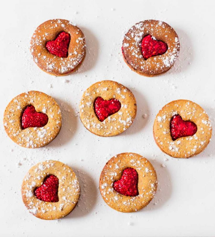 These Vegan Linzer Cookies are made with 4 ingredients and easy to make. A healthier cookie recipe perfect for Valentine's Day or any day! Vegan, gluten-free, oil-free and refined sugar-free.