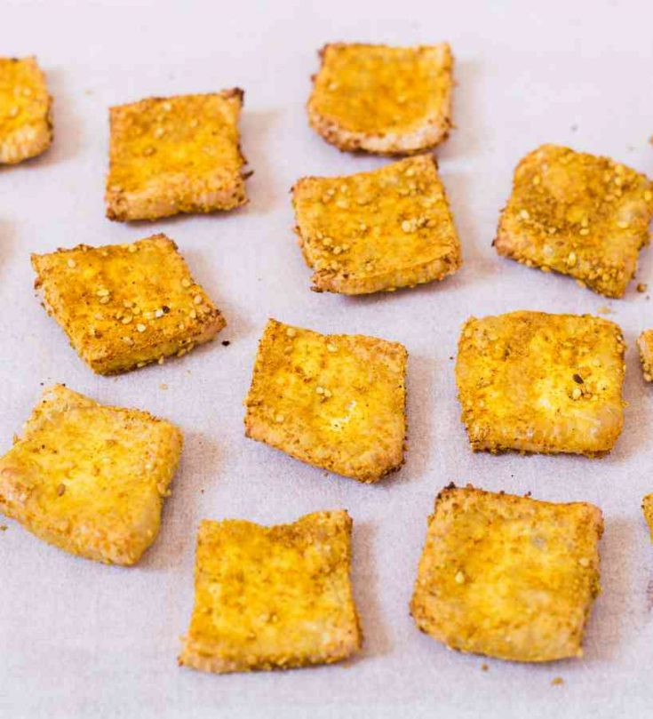 Crispy Baked Tofu is easy to make, healthy and delicious. You can use these crispy tofu bites everywhere from salads to sandwiches.